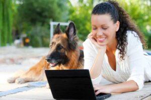 girl with dog on computer
